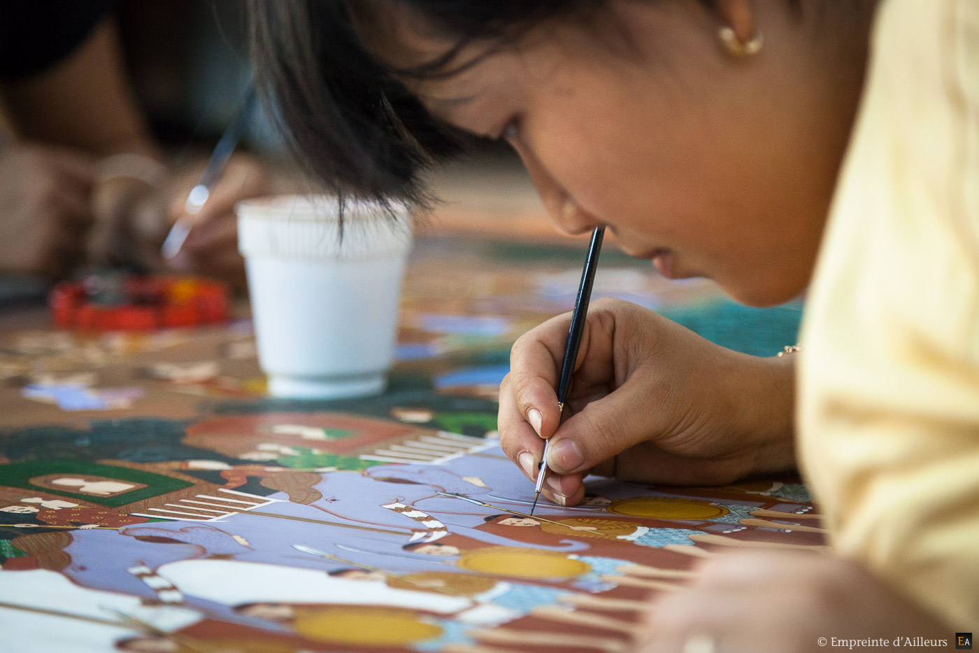 Peintre aux artisans d'Angkor